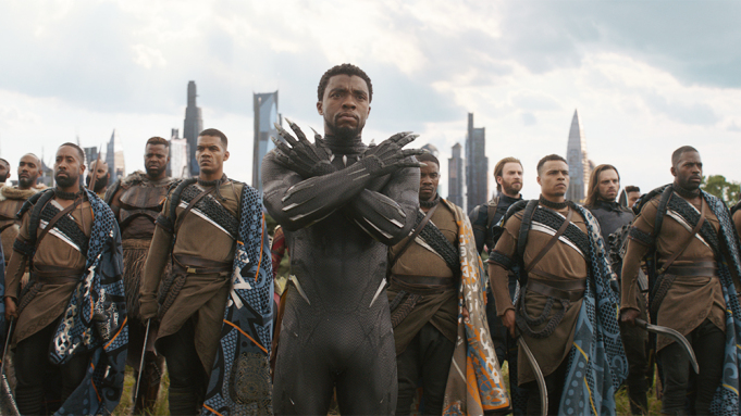 Chadwick Boseman with arms crossed in Black Panther